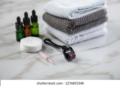 Derma roller and cosmetic vial ampoule for anti ageing lifting treatment in cosmetologist beauty salon