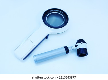 dermatological instruments for examination of moles, birthmarks-Dermatoscope and electronic magnifying glass close-up on a white background. Prevention of melanoma