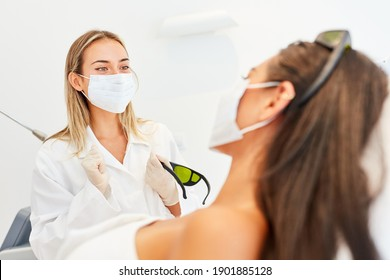 Dermatologist and patient with mask because of Covid-19 in a consultation
