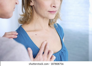 Dermatology check up with woman patient
