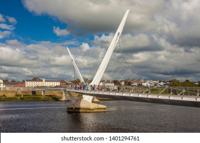 DERRY (LONDONDERRY), NORTHERN IRELAND / UNITED KINGDOM - JUNE 30, 2011: Just opened foot and cycle Peace bridge across Foyle river, connecting ebrington Square with the rest of the city centre