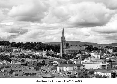 Derry, North Ireland. Aerial view of Derry Londonderry city center in Northern Ireland, UK. Sunny day with cloudy sky, city walls and historical buildings. Black and white