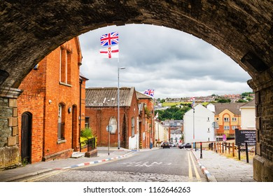DERRY, NORTH IRELAND - JULY 6, 2018:  Aerial view of Derry Londonderry city center in Northern Ireland, UK. Sunny day with cloudy sky, city walls and historical buildings