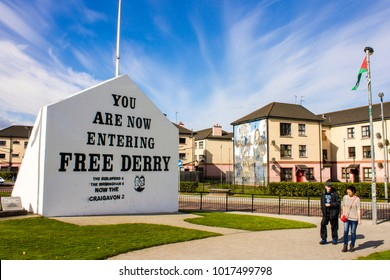 DERRY, NORTHERN IRELAND - May 1, 2015: The 'You are Now Entering Free Derry' Corner in Londonderry, Northern Ireland, with two passersby