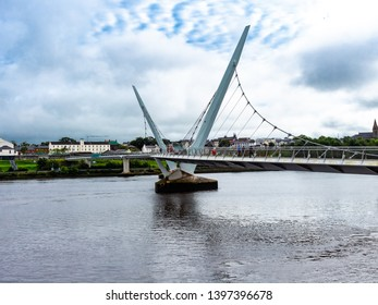 Derry, Northern Ireland - October 2018 -  The Peace Bridge, Londonderry - The bridge over the River Foyle that divides Derry City.