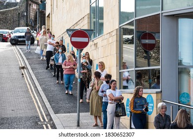 Derry, Northern Ireland- Sept 27, 2020: Long queue outside Primark store in Derry Northern Ireland durring the Covid-19 epidemic.