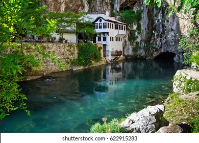 Dervish house on Buna spring with a small waterfall and a cave nearby in a sunny summer day in Blagaj, Bosnia and Herzegovina