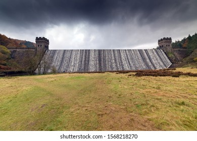 "Derwent dam wall over flowing with cascading water. During the Second World War Derwent Reservoir was used for  practising the low-level flights for the ""Dam Busters"" raids in 1943"