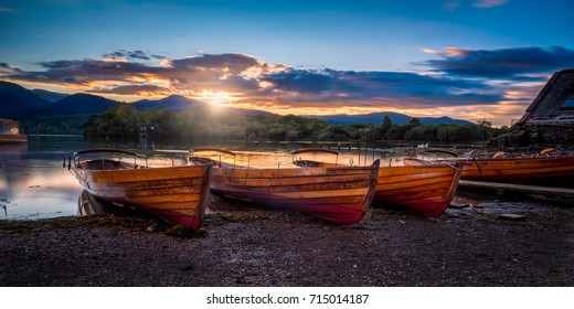 derwent water lake district cumbria uk england at sunset. Rowing boats