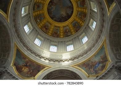 HÔTEL DES INVALIDES, PARIS/FRANCE - DECEMBER 2017: Dome of Hôtel des Invalides, over Napoleon Bonaparte tomb. Golden details and paintings around the dome, Paris/France.