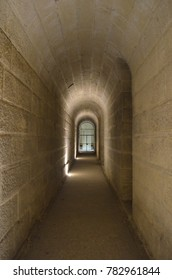 HÔTEL DES INVALIDES, PARIS/FRANCE - DECEMBER 2017: Narrow underground passage with a gate in the end, illuminated and with an exit in the near right side. Paris/France.