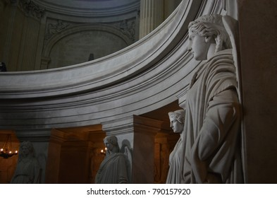 HÔTEL DES INVALIDES, PARIS/FRANCE - DECEMBER 2017: Detail of the tomb of Napoleon Bonaparte, statues around the tomb with natural and artificial lights, Paris/France.