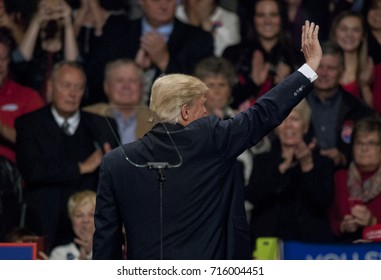 Des Moines Iowa, USA, 8th December, 2016 President Elect Donald Trump at the Victory thank you rally in the Hy-Vee Hall. After speaking to the crowd of 5000 Mr. Trump waves as he leaves the stage