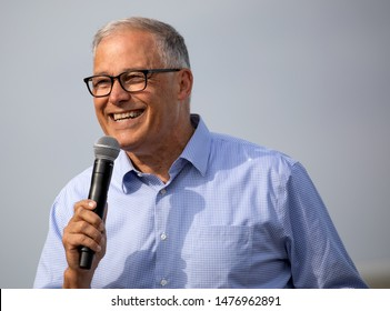 Des Moines, Iowa / USA - August 10, 2019: Washington Governor and Democratic presidential candidate Jay Inslee greets supporters at the Iowa State Fair political soapbox in Des Moines, Iowa.