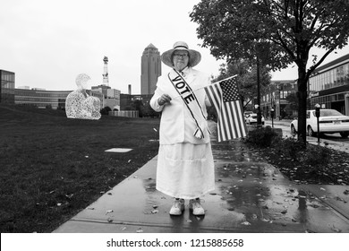 Des Moines, Iowa USA. First day of early voting in Iowa saw modern day suffragettes leading a march to the polls. October 8, 2018.