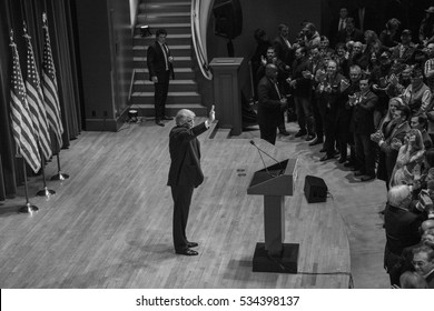 Des Moines, Iowa, USA - January 28, 2016: Republican candidate for President Donald Trump waves to the crowd at a rally for veterans at Drake University's Sheslow Auditorium on January 28, 2016.