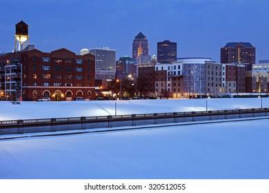 Des Moines skyline across frozen river. Des Moines, Iowa, USA.