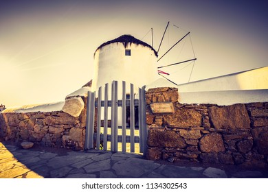 Desaturated closeup view of famous windmill of Mykonos island, Greece