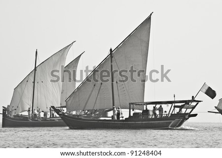 Desaturated image of Arabian dhows, performing during the Qatar National Day festivities in Doha