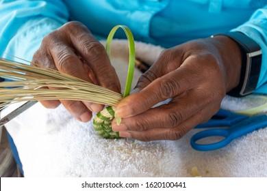 A descendent of slaves, this woman Gullah Geechee master sweetgrass basket weaver creates traditional cultural art on Sapelo Island, Georgia.