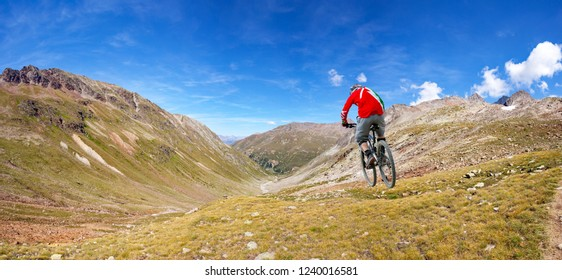 descent by bicycle in the alpine valley