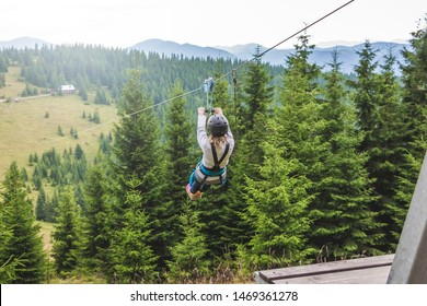 Descent from the mountain on a metal cable. Zipline is an extreme kind of fun in nature