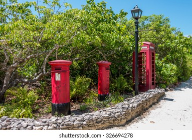 Description: ABACO, BAHAMAS - MAY 22, 2015 â?? Characteristics red mailboxes and telephone box on May 22, 2015 in Man O War Cay Abaco.