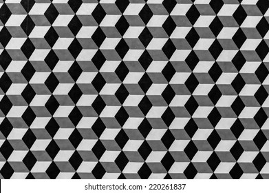 Description:  Geometric design as photographed in black and white Title:  Black and white monochrome geometric background.