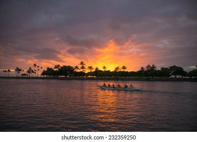 Description:  Honolulu, Hawaii. November 21, 2014, Outrigger Canoe racing at sunset, Honolulu, Hawaii, November 21, 2014.