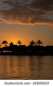 """Description:  Late evening silhouette of Honolulu from the water. Title:  """"Evening Glow in Honolulu""""."""