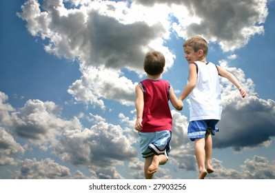 Description: Two boys holding hands running up to heaven