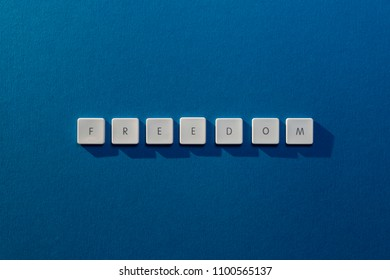 description of the word Freedom with the letters of an old keybord