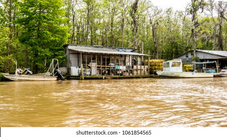descriptive editorial of a cajun community and fish camps located deep in the bayou near the Mississippi and Louisiana border. march of 2018. rising waters are starting to flood this village.