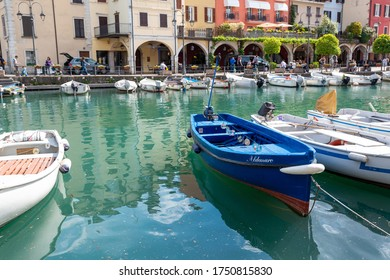 Desenzano del Garda (BS) / Italy - April 30, 2018: View of the boats in the old harbour (Porto Vecchio) in Desenzano del Garda.