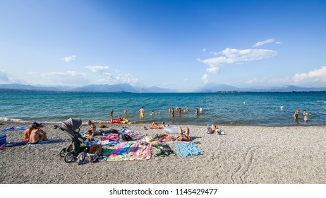 Desenzano del Garda, Italy - July 23, 2018: Garda lake, Public beach near Desenzano del Garda in a beautiful summer day