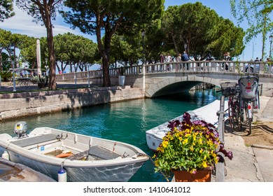 Desenzano del Garda, Italy, on April 27, 2019. The picturesque bay from the beautiful embankment. Boats are moored near the embankment.