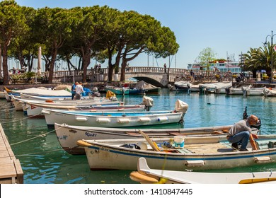 Desenzano del Garda, Italy, on April 27, 2019. The picturesque bay from the beautiful embankment.Boats are moored near the embankment.