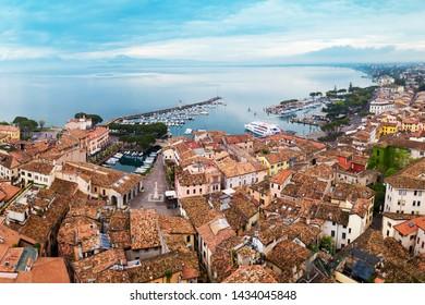 Desenzano del Garda port aerial panoramic view. Desenzano is a town on the shore of Lake Garda in the Brescia province in Lombardy, Italy.