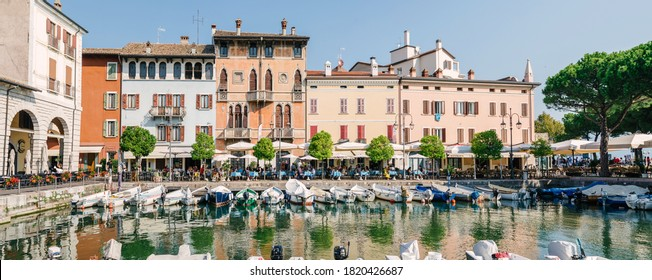 Desenzano Lake Garda, Italy - September 13, 2020: boats anchored in the small port of the historic center