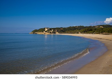 desert beach with a castle background in Tamarit, Altafulla, Tarragona, Catalonia, Spain