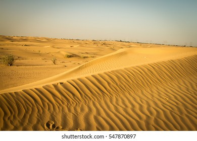 Desert - colourful patterns & sky is visible behind
