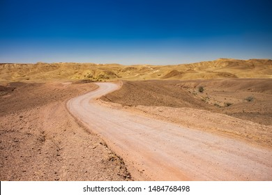 desert dry wasteland valley horizon scenic landscape view with lonely curved ground trail in Middle East hot environment