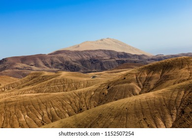 Desert and eroded area of the Peruvian Andes, Ica region and white hill the highest dune in the world