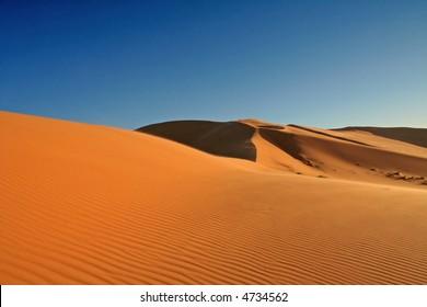 Desert in Hasi Labied, Moroco, Africa. Interesting colored sand dunes. Popular travel destination.