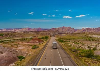 Desert highway in Utah with semi-truck