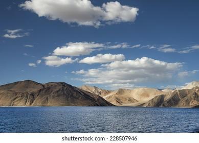 Desert hills and deep blue mountain lake