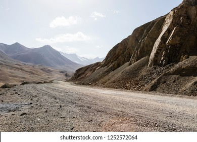 Desert landscape in the area of Ak-Baital Pass with road in the Pamir Mountains in Tajikistan