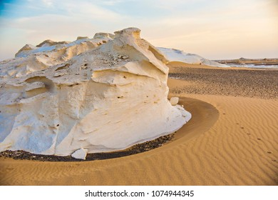 Desert landscape in Egypt. White desert in Egypt (Farafra). White stones and yellow sands.