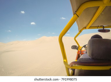 A desert landscape from the perspective of a dune buggy.