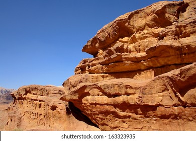 Desert Landscape with Rock Formations and Blue Sky, Wadi Rum, Jordan